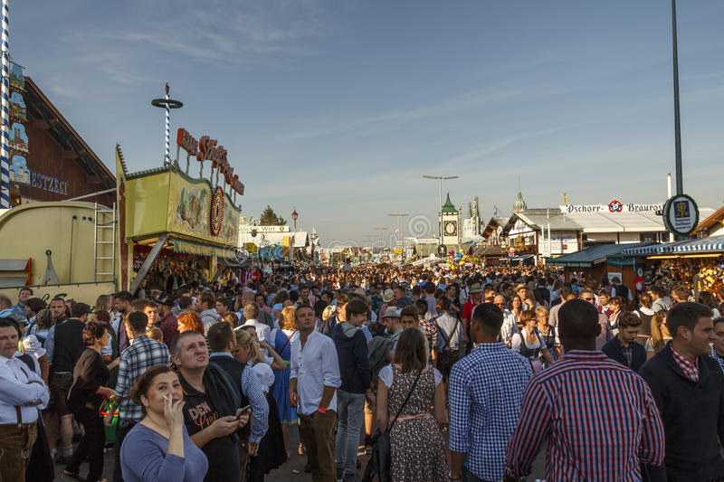 Main street at Oktoberfest in Munich, Germany, 2016. Munich, Germany - September 24, 2016: Main street on Theresienwiese fairground with large beer tents and stock photo