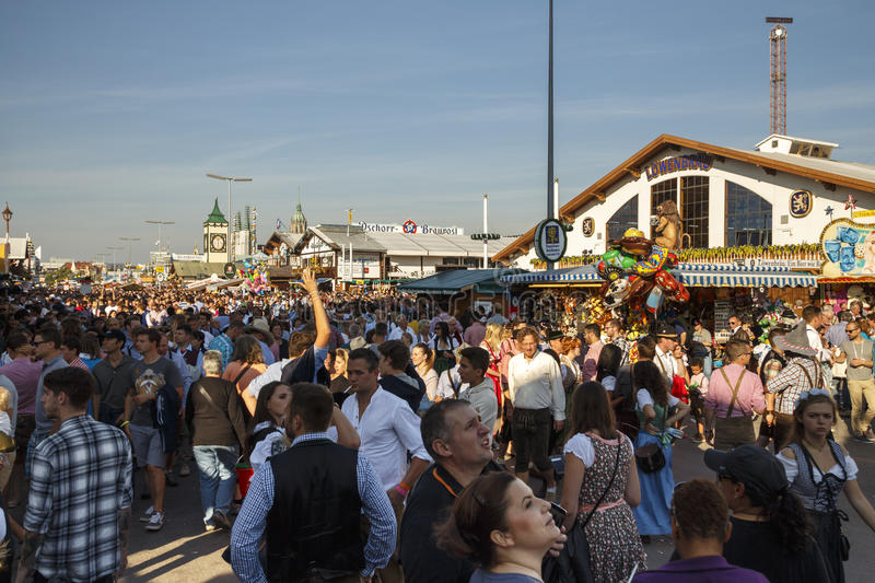 Main street at Oktoberfest in Munich, Germany, 2016. Munich, Germany - September 24, 2016: Main street on Theresienwiese fairground with large beer tents and stock photography