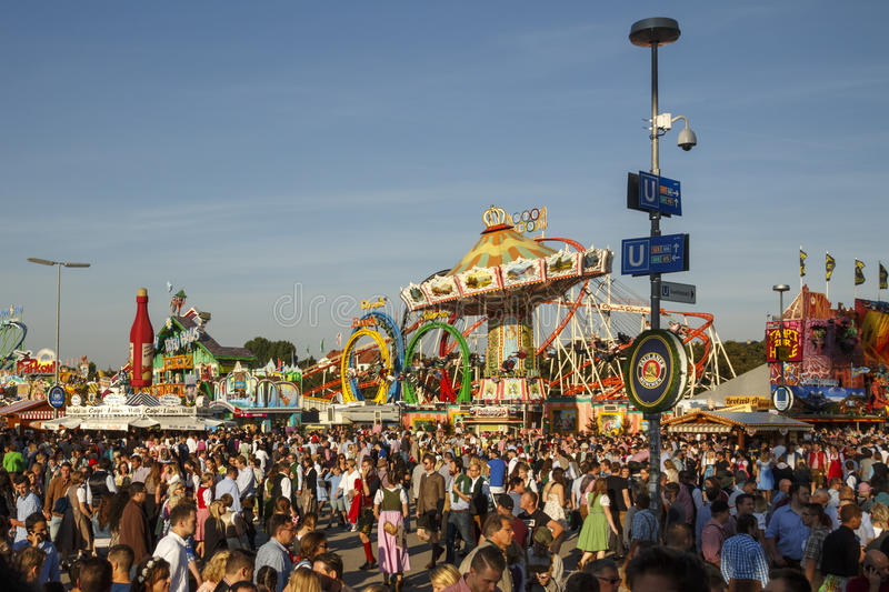 Main street at Oktoberfest in Munich, Germany, 2016. Munich, Germany - September 24, 2016: Main street on Theresienwiese fairground with large beer tents and royalty free stock photography
