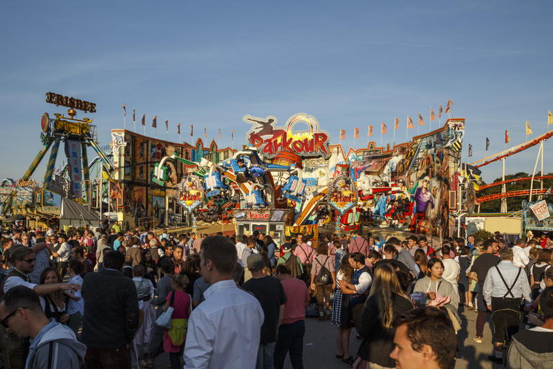 Main street at Oktoberfest in Munich, Germany, 2016. Munich, Germany - September 24, 2016: Main street on Theresienwiese fairground with large beer tents and stock image