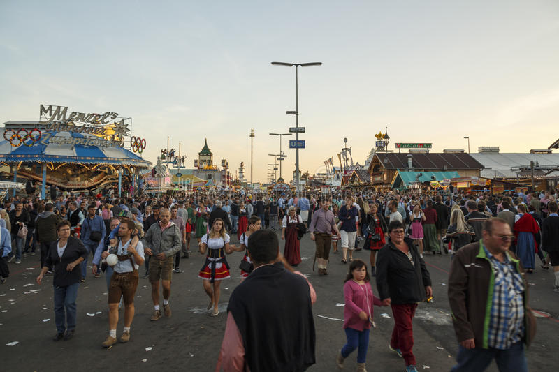 Main street at Oktoberfest in Munich, Germany, 2016. Munich, Germany - September 24, 2016: Main street on Theresienwiese fairground with large beer tents and royalty free stock photo