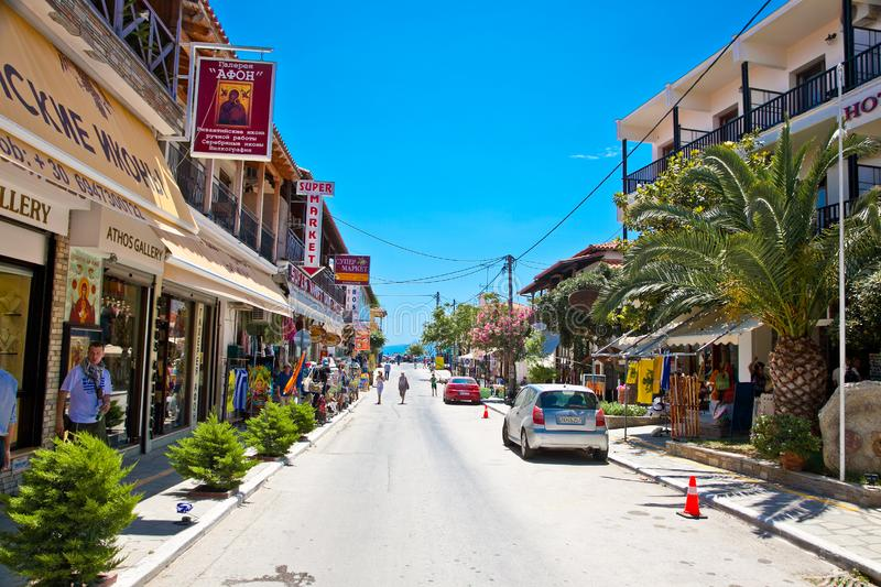 Main street of Ouranoupolis, Greece. ATHOS, GREECE-MAY 25, 2014: Main street of Ouranoupolis one of the most attractive, but perhaps lesser known corners of royalty free stock images