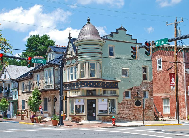 Main Street in Smyrna Delaware. Historic main street downtown in Smyrna Delaware, brick and green stucco facades, a dome, traffic light, landscaping, Main street stock images