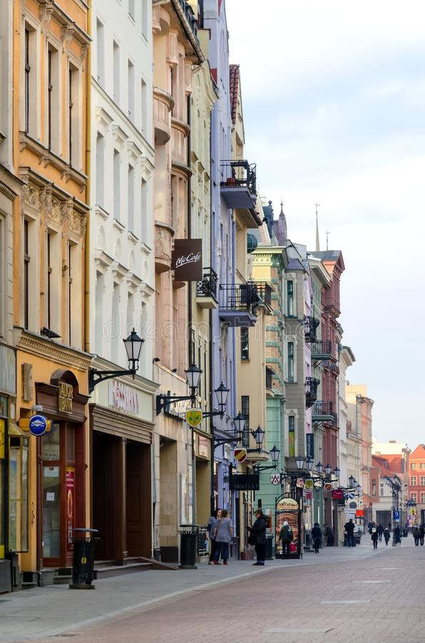 Main street in Torun (Poland). TORUN, POLAND - FEBRUARY 21, 2015: Main street in Torun (Poland). Tenement houses in old town Torun, listed by UNESCO stock photos