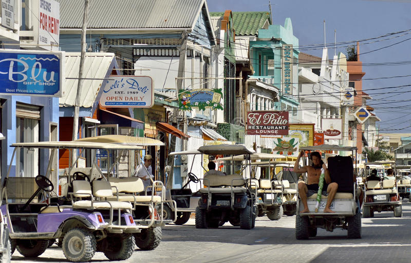 Main street on the tropical island of Ambergris Caye, Belize. The main street on Ambergris Caye is filled with golf carts as they are the primary mode of travel royalty free stock photos