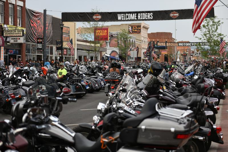 Main Street during the worlds largest motorcycle rally in Sturgis. Motorcycle riders and motorcycles on Main Street during the worlds largest motorcycle rally in royalty free stock photo