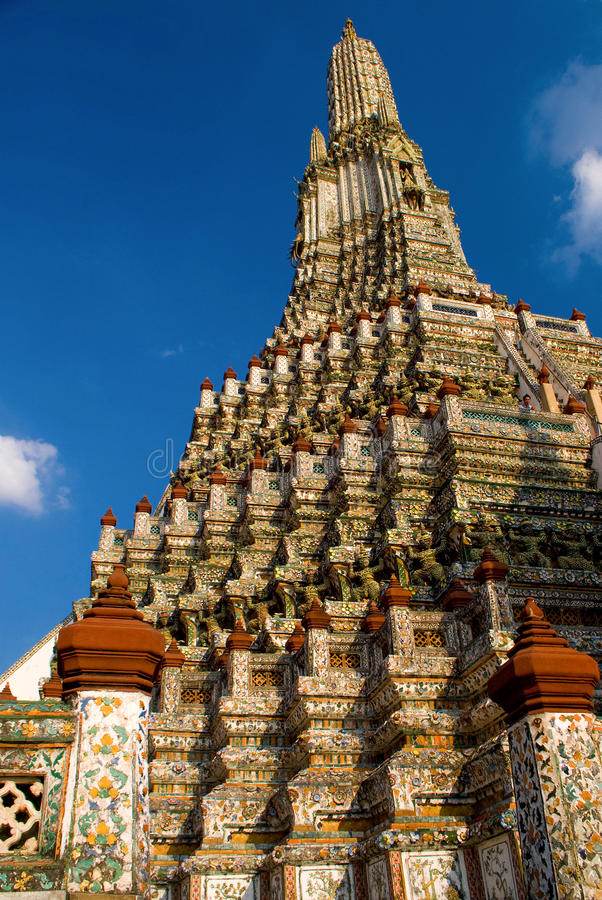 Main stupa of Wat Arun. Wat Arun is among the best known of Thailand's landmarks and the first light of the morning reflects off the surface of the temple with royalty free stock photos