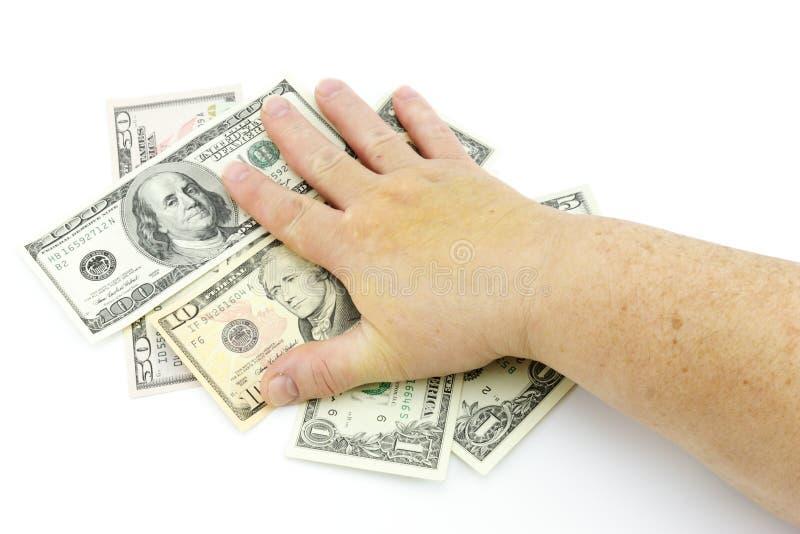 Main sur des dollars images libres de droits