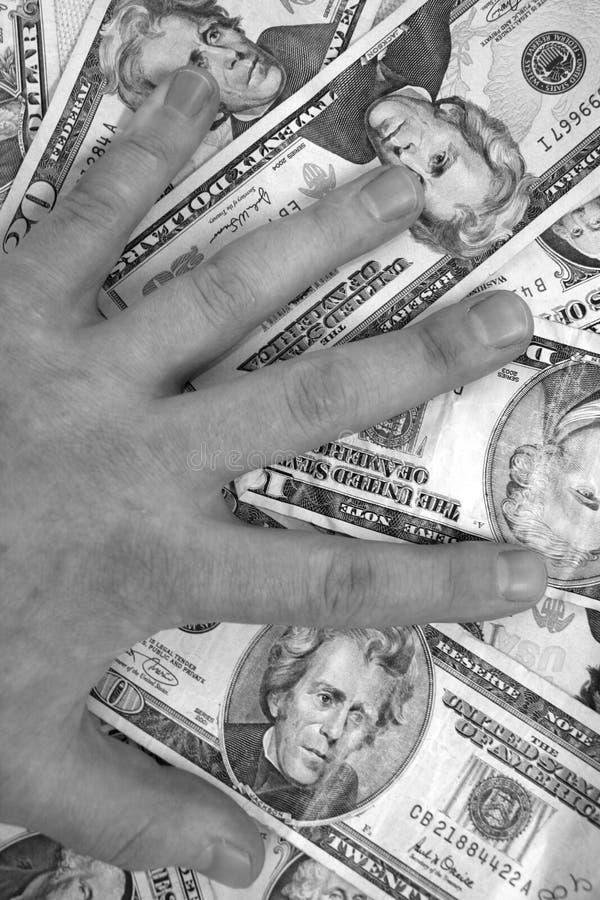 Main sur l'argent image libre de droits