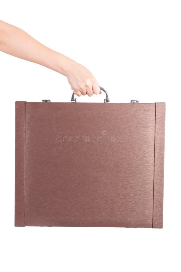 Main tenant à disposition une serviette photo libre de droits