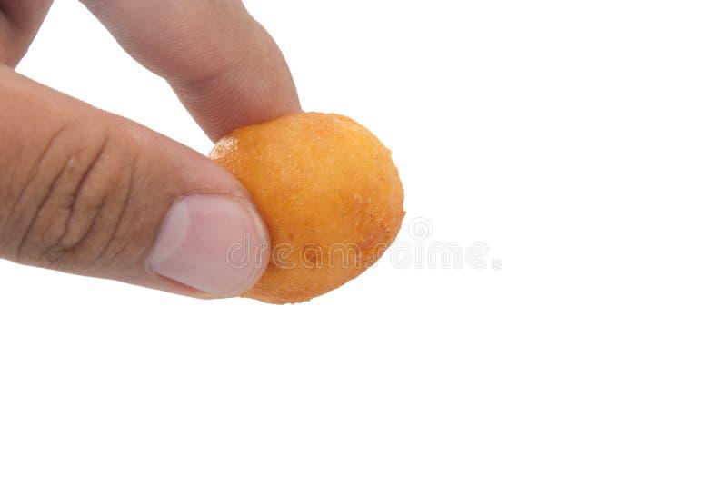 Main tenant Fried Sweet Potato Balls photographie stock libre de droits