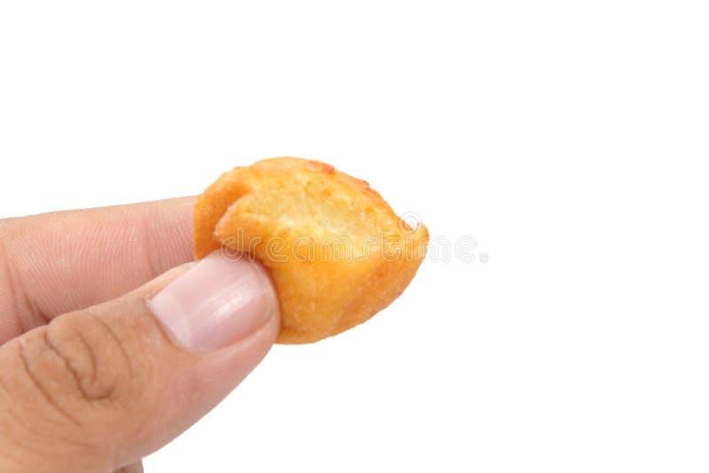Main tenant Fried Sweet Potato Balls photos libres de droits