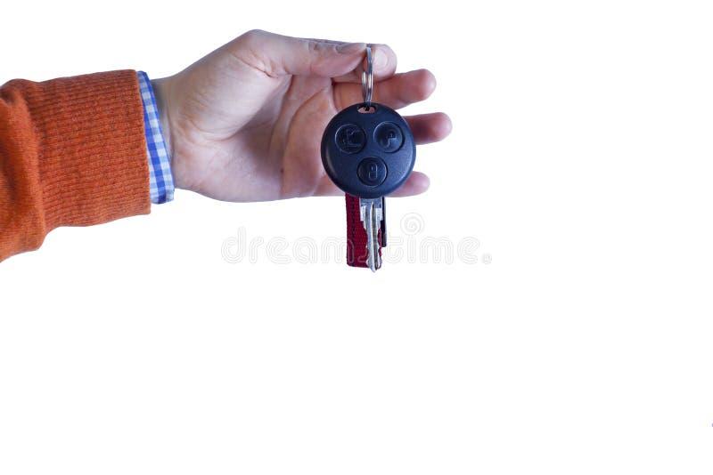 Main tenant la clé de voiture images stock
