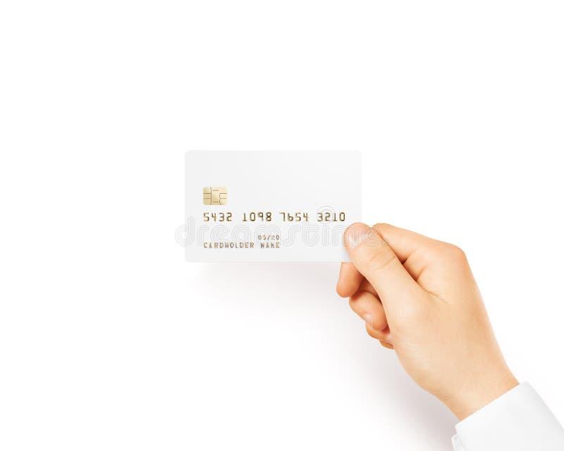 Main tenant la maquette blanche vide de carte de crédit images stock