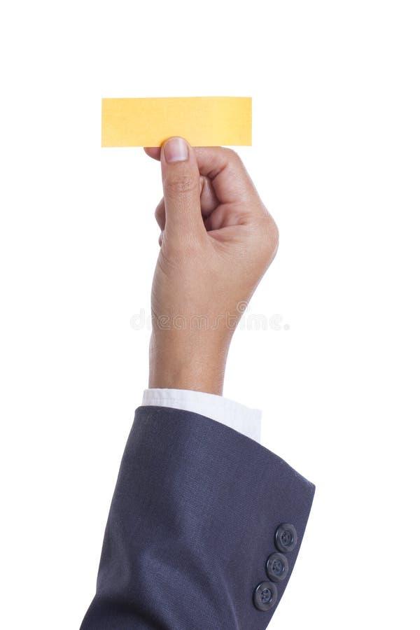 main tenant la note collante, photos stock