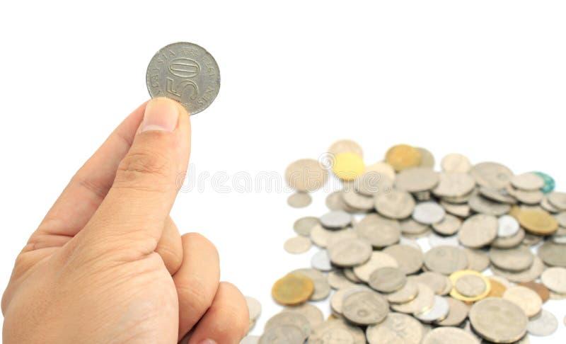 Main tenant la pièce de monnaie photographie stock libre de droits