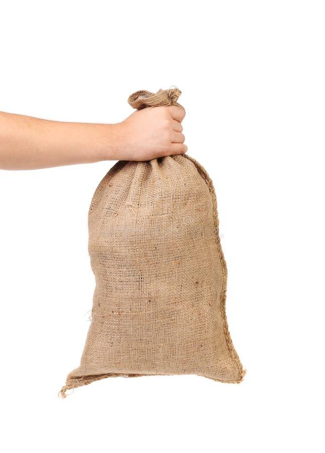 Main tenant le plein sac. image stock
