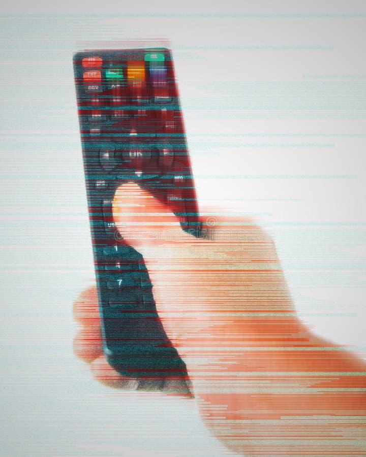 main tenant un à télécommande sur le fond blanc, en gros plan, effet de problème de Digital image libre de droits