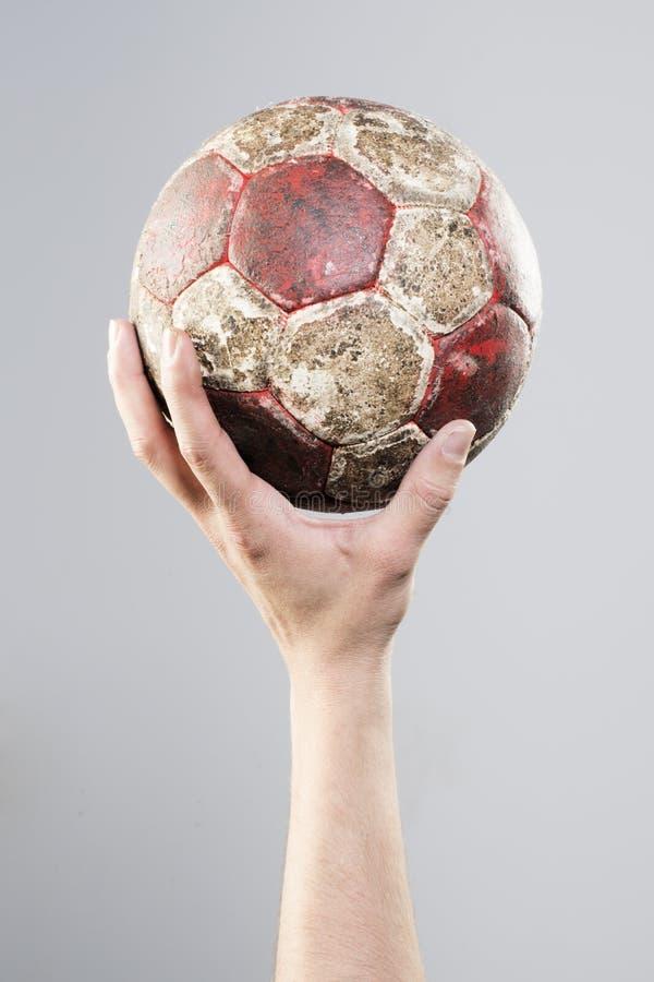 Main tenant un handball photos stock