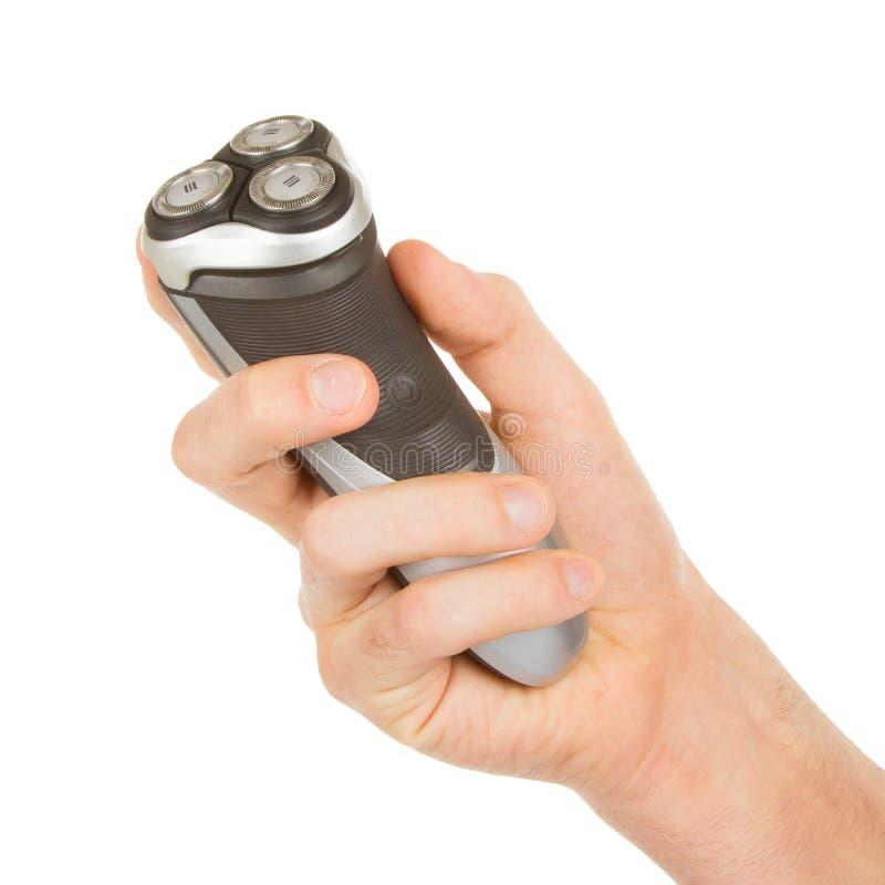 Main tenant un rasoir électrique image stock