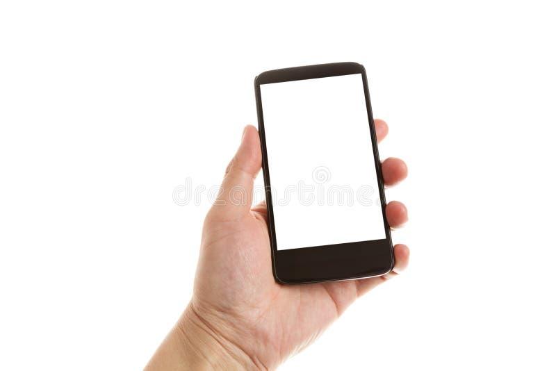 Main tenant un téléphone portable images libres de droits