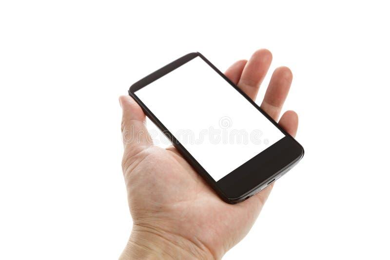 Main tenant un téléphone portable photo libre de droits