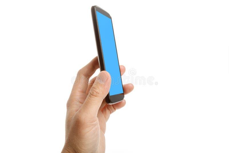 Main tenant un téléphone portable image libre de droits