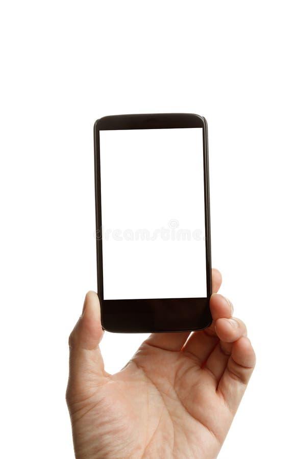 Main tenant un téléphone portable photo stock