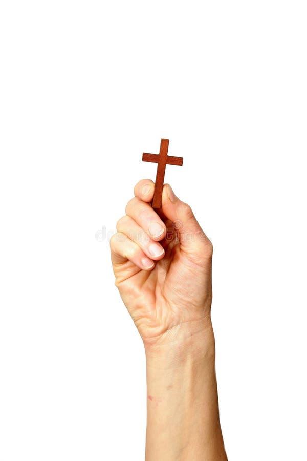 Main tenant une croix vers le haut de haute image stock