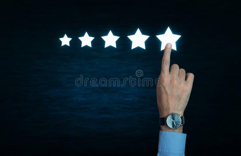 Main touchant 5 étoiles images libres de droits