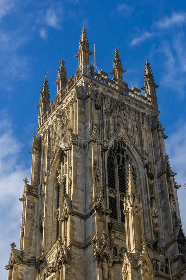 Main tower York Cathedral. The top of the main tower of York Cathedral with blue sky behind royalty free stock photography