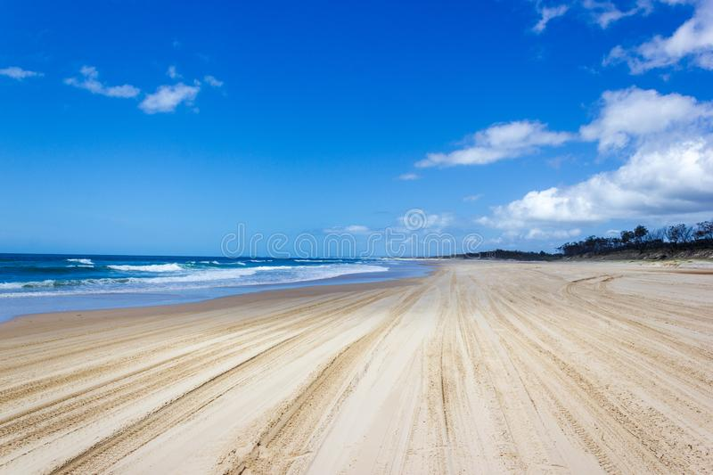 Main transportation highway on Fraser Island - wide wet sand beach coast facing Pacific ocean - long 75 miles beach stock image
