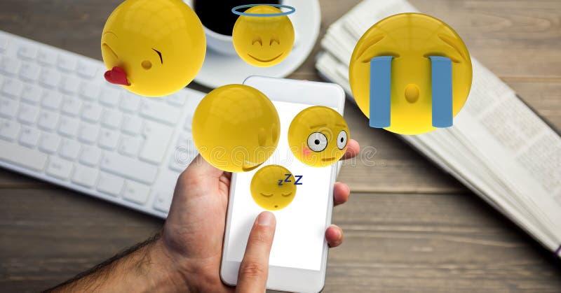 Main utilisant des emojis au téléphone intelligent illustration libre de droits