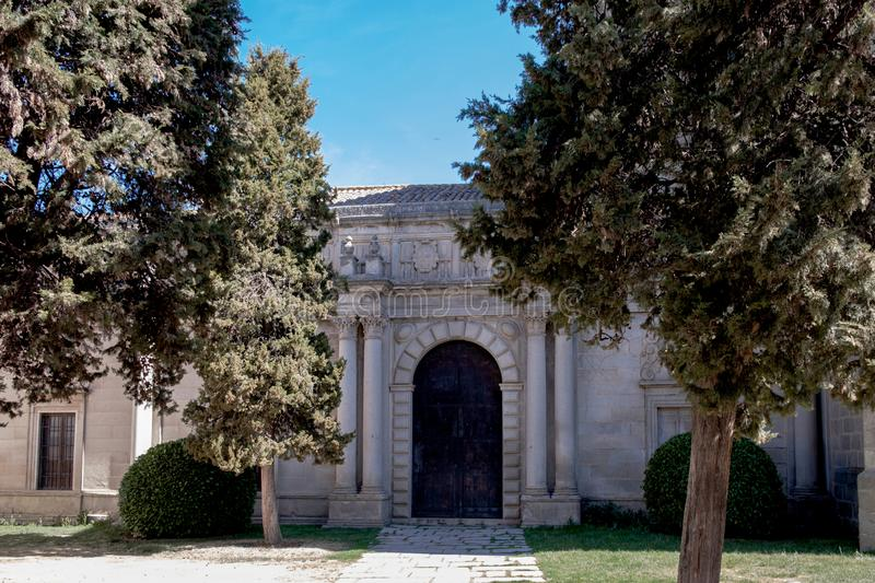 Main view of church in Avila, garden and main door, Spain. Main view of church in Avila, Spain, with garden and blue sky Mosen Rubi chapel royalty free stock images