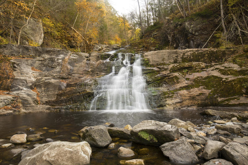 Main waterfall at Kent Falls State Park in western Connecticut. Blurred long exposure of the main waterfall at Kent Falls State Park in Kent, Connecticut, with royalty free stock photos