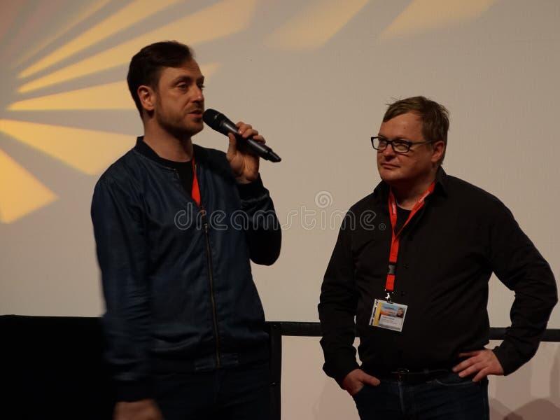 Mainactorregen Tolk l en Directeur Andres Maimik r in Internationales Filmfestival Mannheim-Heidelberg 2017 stock afbeeldingen