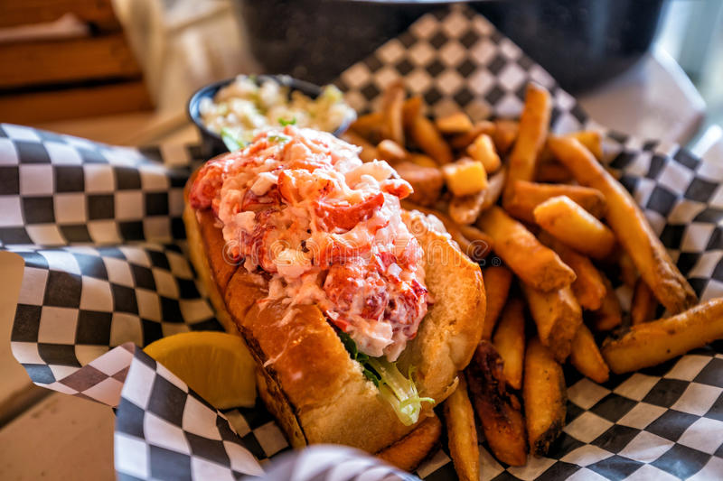 Maine lobster roll. Served on plate royalty free stock images