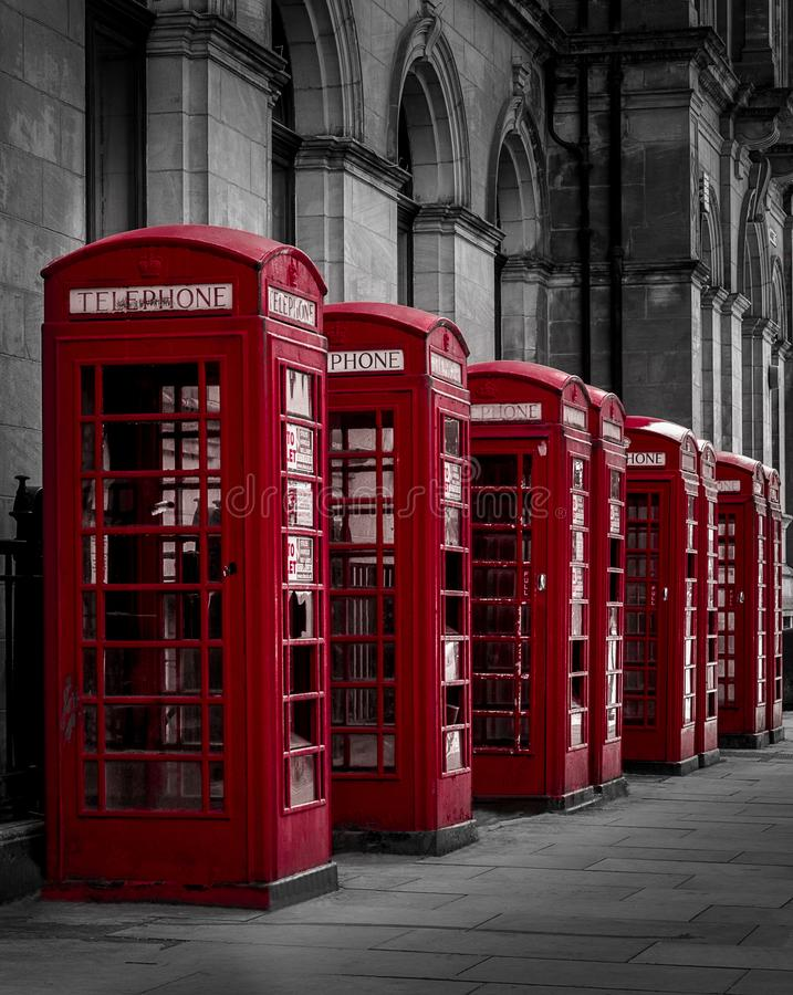 The Red Phone Boxes. A mainly black and white shot with the phones boxes in their natural red standing out from the background on a Preston City Street royalty free stock images