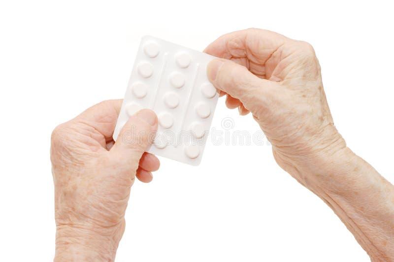 Mains aînées avec des tablettes images stock