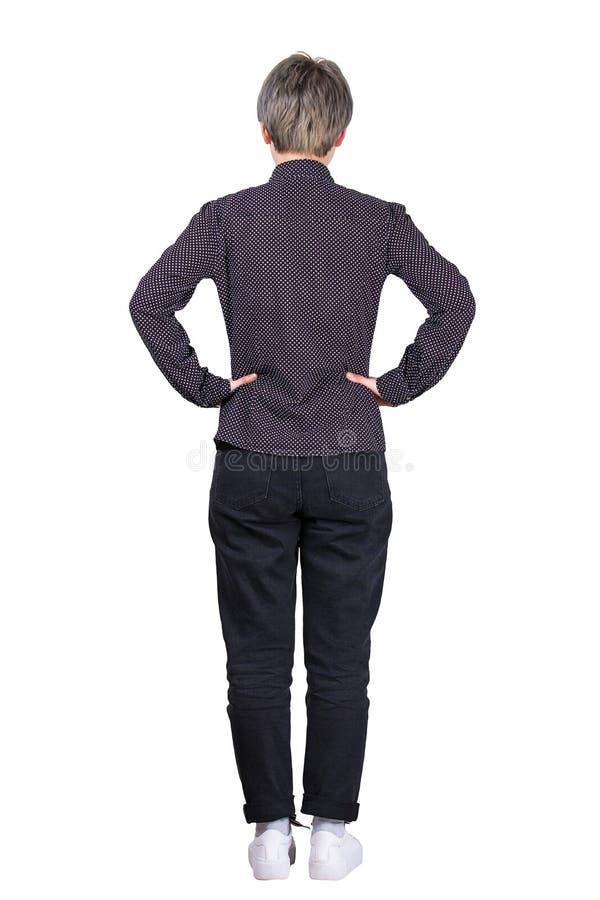 Mains arrière de femme sur des hanches images libres de droits