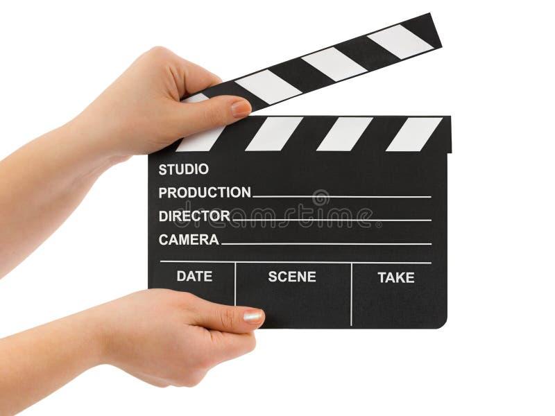 Mains avec le bardeau de cinéma photo libre de droits