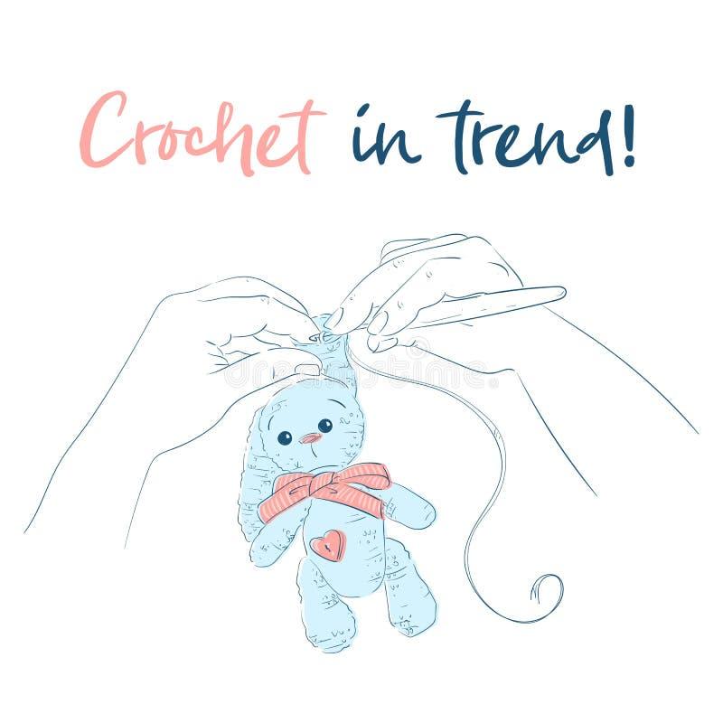 Mains avec un lapin de crochet de crochet handmade illustration stock