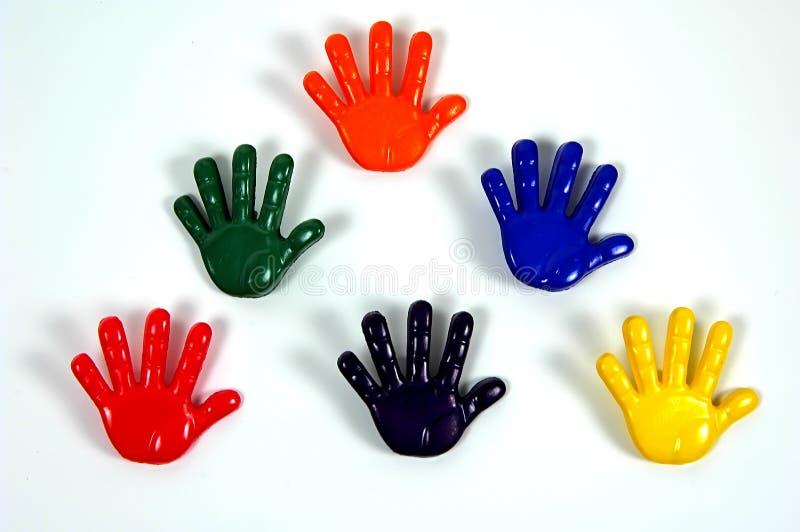 Mains colorées images stock