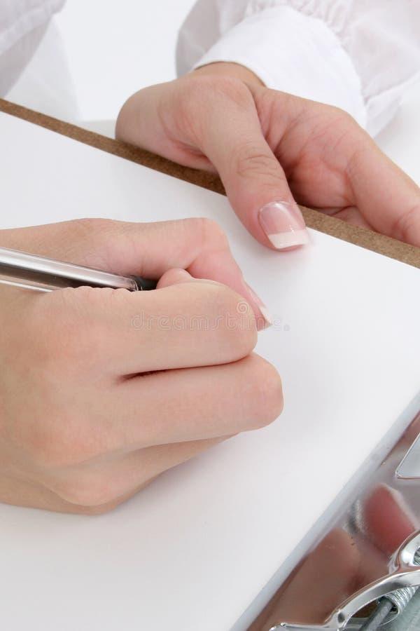 Mains d'écriture images libres de droits
