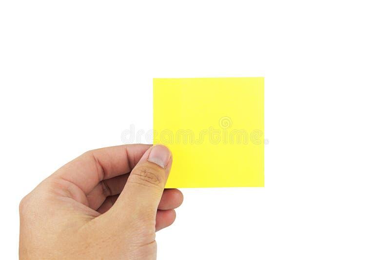 Mains d'homme tenant le papier de notes collant image libre de droits