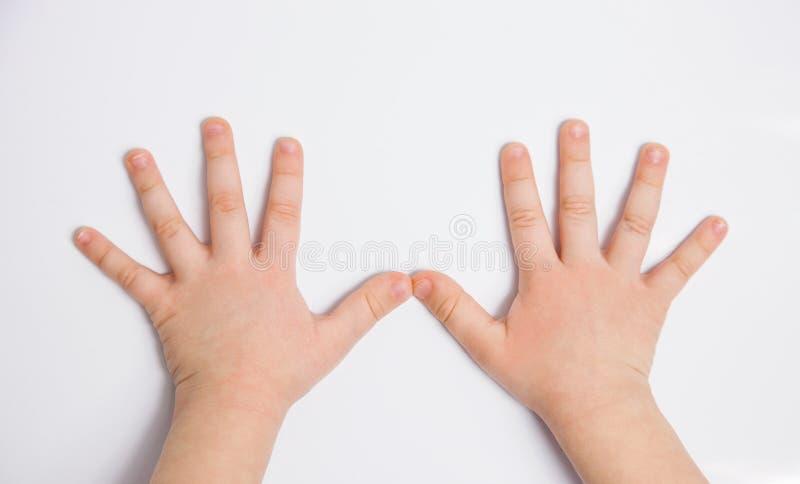 Mains d'un enfant photographie stock