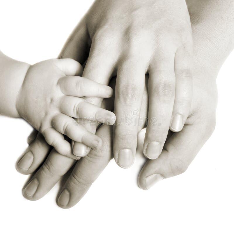 Mains d'une famille photos libres de droits