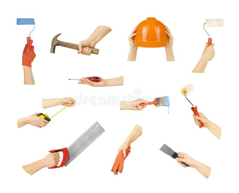 Mains de collection avec des outils de construction photo libre de droits