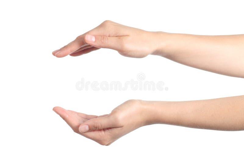 Mains de femme avec un geste de protection photo libre de droits