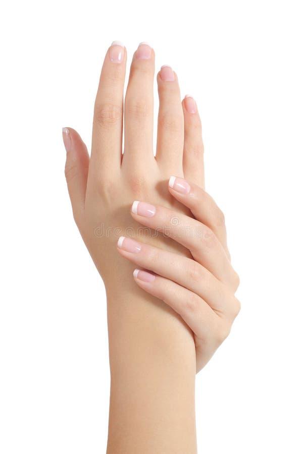 Mains de femme de beauté avec la manucure française parfaite photographie stock libre de droits